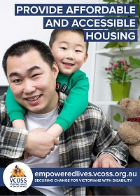An asian man who is blind sits on the floor of his lounge room while his young son climbs on his back - they are both smiling