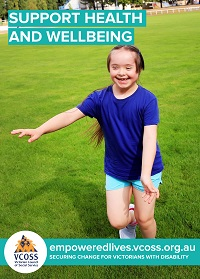 A young girl with disability is running across a sporting oval smiling