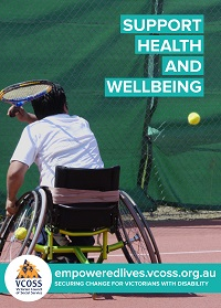 Man in wheelchair playing tennis taking a swing at the ball